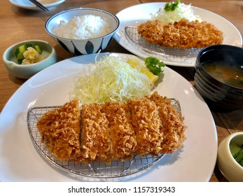 Crispy tonkatsu is on a white plate. Place of origin is Japan.