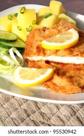 Crispy Vienna schnitzel with potatoes and salad