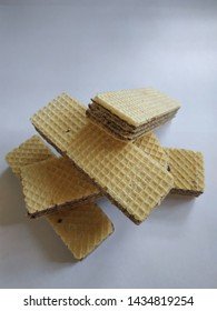 Crispy wafer brown color on a white background