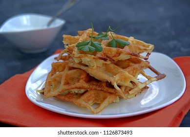 Crispy waffle hash browns or pancakes from shredded potatoes. Served with sour cream