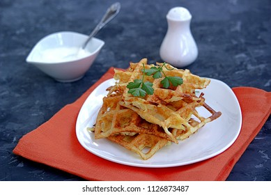 Crispy waffle hashbrowns or pancakes from shredded potatoes in waffle iron. Served with sour cream