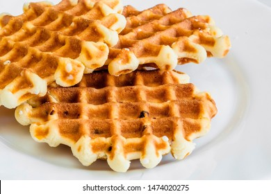 Crispy waffles fries, wavy, crinkle cut, criss cross cries isolated on white background