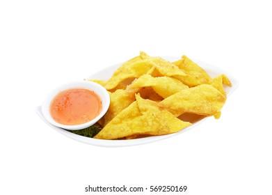 Crispy wonton with chili sauce isolated on white background.