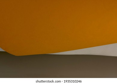 Crisscrossing orange, gray and white lines and surfaces.