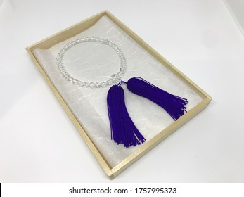 Cristal buddhist rosary  in the wooden box, white background