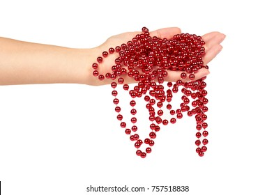 Cristmas decoration, ceramic red ball chain in hand isolated on white background. New Year object, Mardi Gras beads