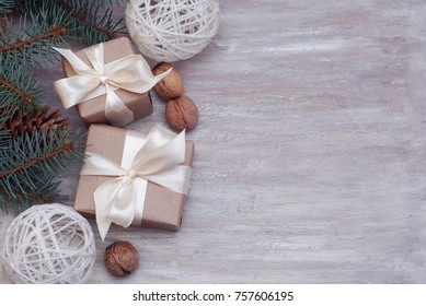 Cristmas Gift Present Brown Box with, Fir Brances, Nuts and Winter Decorations. Text Space. Rustic Style