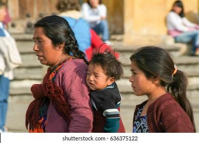Cristobal de las Casas, Mexico - 19 January 2009: maya woman with her children at San Cristobal de las Casas on Chiapas, Mexico