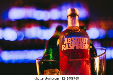 Cristur, Romania - November 23, 2018: Absolut Vodka Raspberri with Sprite and blur background