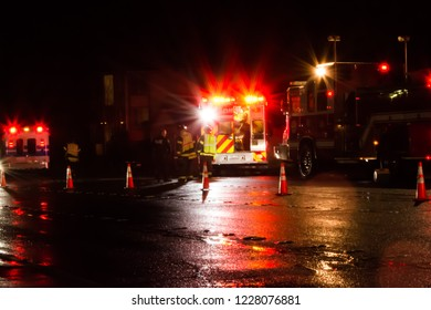 Critical collision response by firefighters, medics, and police officers on a wet night