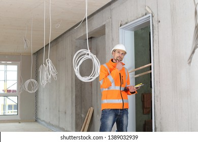 A Critical construction expert appraiser checking a constructin site
