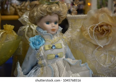 Critical, ruthless and noble lady doll with blue eyes in an expensive dress