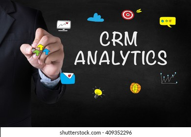 CRM ANALYTICS Businessman drawing Landing Page on blurred abstract background