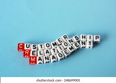 CRM Consumer Relationship Management on cubes , definition  acronym on blue