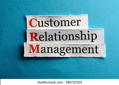 CRM customer relation management abbreviation on blue paper