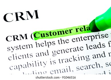 CRM customer relationship management definition highlighted by green marker on white paper background