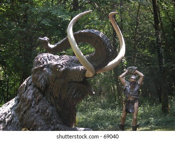 Cro magnon man  hunting a mammuth (models in a theme park)
