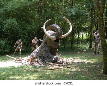 Cro magnon people hunting a mammuth (models in a theme park)