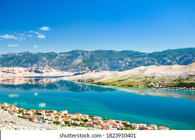 Croatia, Adriatic coastline, town of Pag on Pag island and Velebit mountain in background