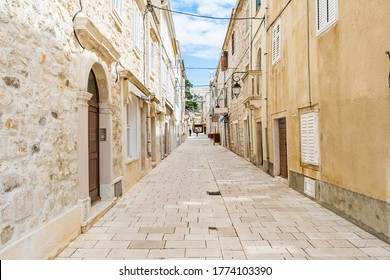 Croatia, beautiful old cobbled street, traditional houses and in the old historical town of Pag