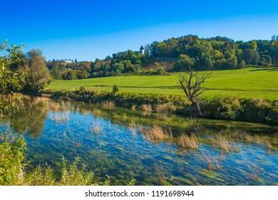 Croatia, countryside landscape, river Dobra and old fortress in Novigrad, Karlovac county
