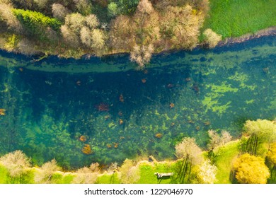Croatia, Dobra river from air, top down view from drone, Karlovac county, green surface of clear water in autumn