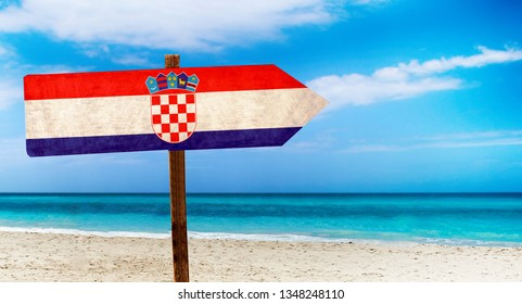 Croatia flag on wooden table sign on beach background. It is summer sign of Croatia.