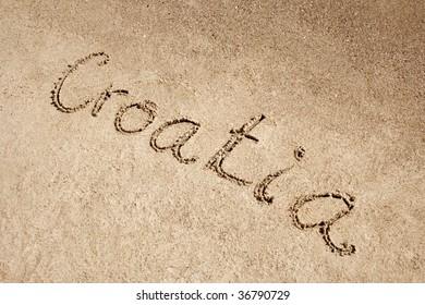 Croatia handwritten in sand on a beach