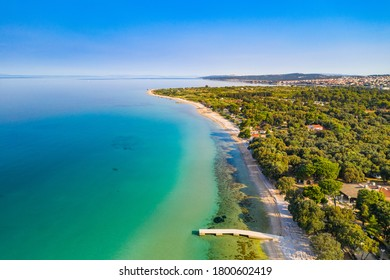 Croatia, island of Pag, beautiful touristic resorts, long beaches under pine trees, Adriatic Sea on sunny summer day. Aerial drone view.