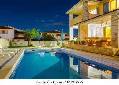 Croatia, Istria, Pula, holiday house with pool at night