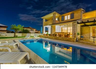 Croatia, Istria, Pula, holiday house with pool at night