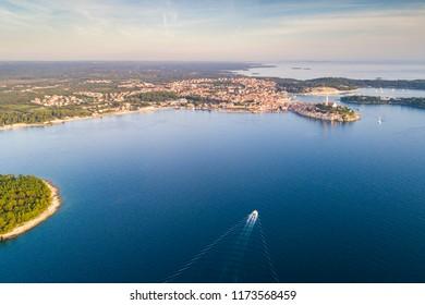 Croatia, Istria, Rovinj, aerial view with boat and small island