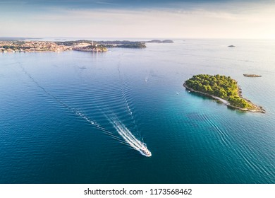 Croatia, Istria, Rovinj, aerial view with boat and small island