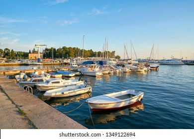 CROATIA – JULY 17, 2018: Ships in the port of Porec on the Adriatic coast in Croatia. Porec is one of the most popular port cities in Croatia.