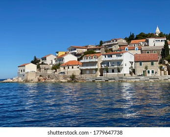 Primošten, Croatia - July 9 2020: The small harbor of Primosten on the Croatian Dalmatian coast with its Venetian architecture