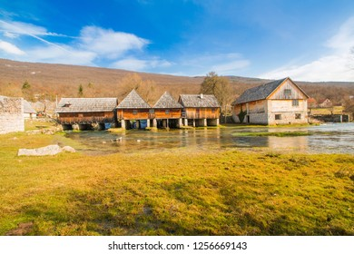 Croatia, Lika, old wooden water mills in on Majerovo vrilo, source of Gacka river, rural countryside landscape