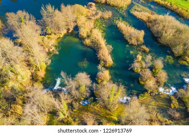 Croatia, Mreznica river from air, drone shoot, top down view, Karlovac county, green nature, wood and waterfalls in autumn
