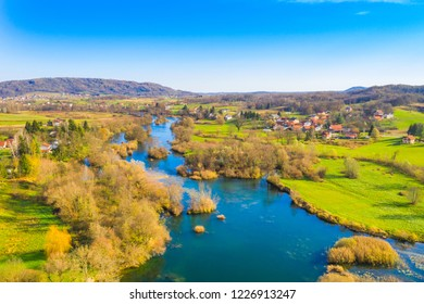 Croatia, Mreznica river from air, panoramic view of Belavici village and waterfalls in autumn
