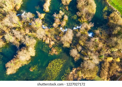 Croatia, Mreznica river from air, top down view, Karlovac county, green nature, beautiful waterfalls in autumn