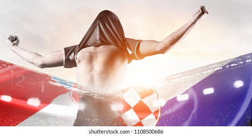 Croatia national team. Double exposure photo of stadium and soccer or football player celebrating goal with his jersey on head