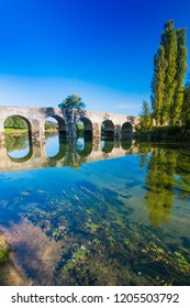 Croatia, old stone bridge over the river Dobra and in Novigrad, Karlovac county