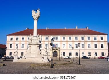 Croatia, Osijek, Holy Trinity Monument, Behind is Building of University of Osijek