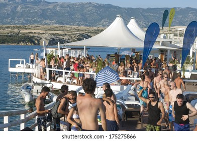CROATIA, PAG Island - AUGUST 5, 2011: Big crowd of swimmers partying on a hot summer day on Zrce beach, Novalja, Pag island, Croatia, Adriatic sea. Zrce beach is the most popular party destinations