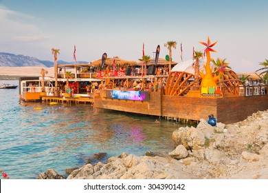CROATIA, PAG ISLAND - JULY 25, 2015: Crowd of young people partying on a hot summer day on Zrce beach, Novalja, Pag island, Croatia. Zrce beach is the most popular party destination on Adriatic sea.