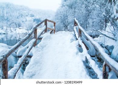 Croatia, Plitvice lakes, footpath under snow the in popular tourist destination nature park Plitvicka jezera in winter