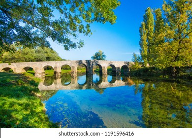 Croatia, river Dobra and old stone bridge in Novigrad, Karlovac county