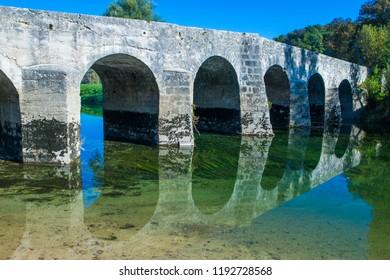 Croatia, river Dobra and old stone bridge in Novigrad, Karlovac county