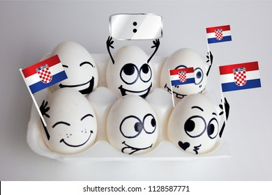 croatia soccer championship. concept of emotional cheerleaders-eggs. funny fans with flags in their hands with a banner above their head for the numbers