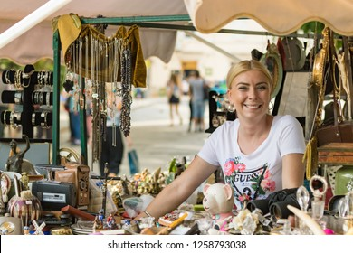 Croatia, Split - September 22th, 2018: Portrait of a woman selling antique objets in a street market in Split, Croatia.