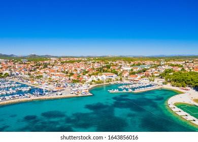 Croatia, town of Vodice on  Adriatic sea, marina and turquoise coastline, drone aerial view, beautiful seascape